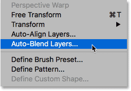 Selecting Auto-Blend Layers from under the Edit menu in Photoshop.