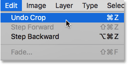 Choosing the Undo Crop command from under the Edit menu. Image © 2016 Steve Patterson, Photoshop Essentials.com