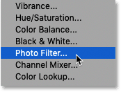 Adding a Photo Filter adjustment layer to the Photoshop document.