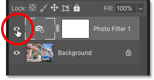 Clicking the Photo Filter adjustment layer's visibility icon in Photoshop