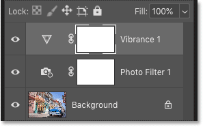Photoshop's Layers panel showing the Vibrance and Photo Filter adjustment layers