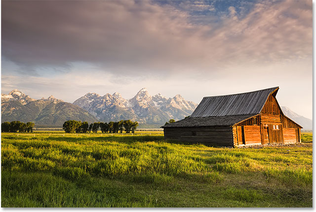 Iconic T. A. Moulton barn and Teton peaks at dawn in Grand Teton National Park, WY.  Image licensed from Shutterstock by Photoshop Essentials.com