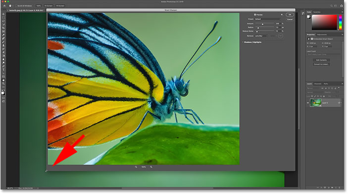 Resizing Photoshop's Smart Sharpen dialog box for a larger sharpening preview.