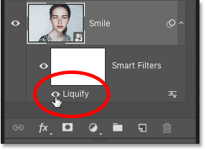 Photoshop's Layers panel showing the Liquify smart filter