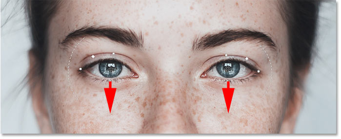 Lowering the eyes to enhance the smile in Photoshop