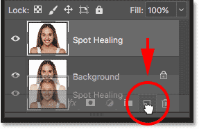 Making a copy of the Spot Healing layer in the Layers panel in Photoshop