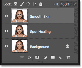 The original image, the Spot Healing layer and the Smooth Skin layer in the Layers panel in Photoshop