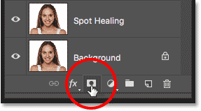 Clicking the Add Layer Mask icon in the Layers panel in Photoshop