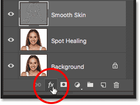 Clicking the Layer Styles icon in the Layers panel in Photoshop