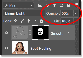 Lowering the opacity of the Smooth Skin layer in Photoshop