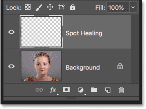 The Spot Healing layer above the image in the Layers panel in Photoshop
