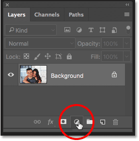 Clicking the New Fill or Adjustment Layer icon in the Layers panel in Photoshop