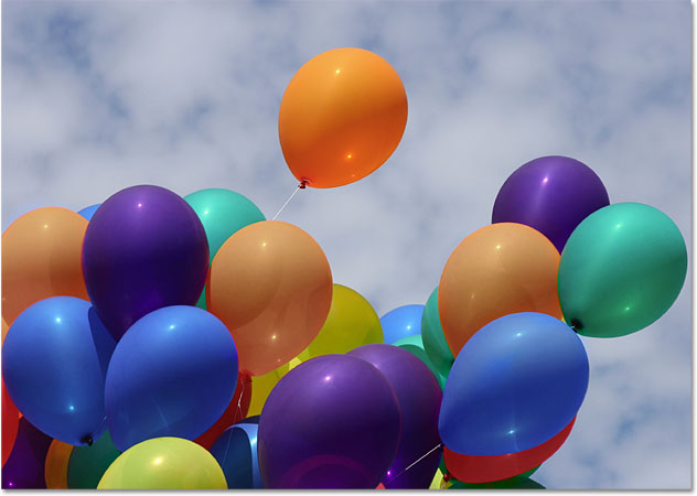 The balloons after reducing their color saturation. Image © 2010 Photoshop Essentials.com