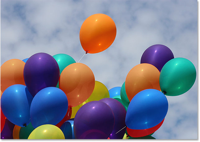 The balloons after reducing their color saturation. Image © 2016 Photoshop Essentials.com