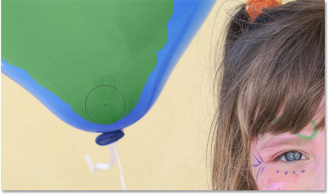 Continuing to paint over the balloon with the Color Replacement Tool. Image © 2016 Photoshop Essentials.com