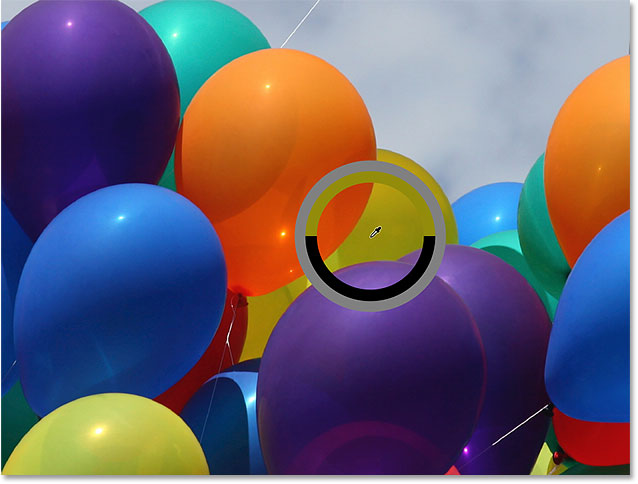 Sampling a color from one of the balloons in the photo. Image © 2016 Photoshop Essentials.com