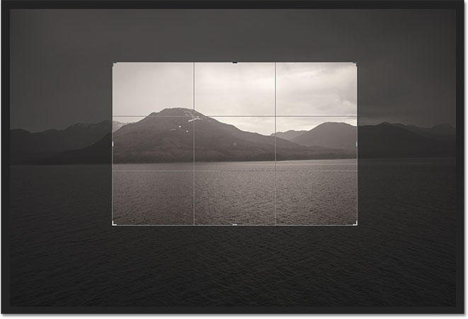 The crop border has snapped to a 4x3 aspect ratio. Image © 2012 Photoshop Essentials.com
