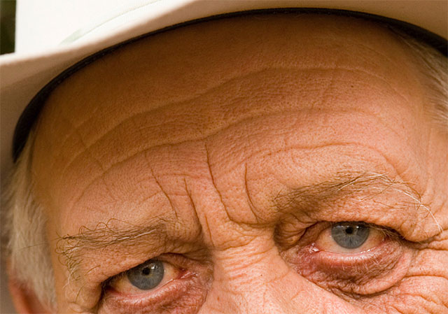 A close-up of the man's forehead showing the original wrinkles. Image © 2016 Photoshop Essentials.com