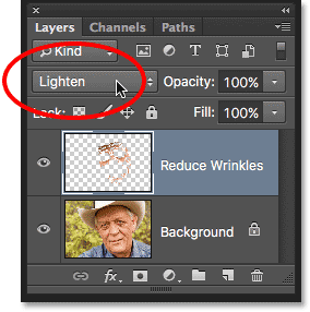 Changing the blend mode of the Reduce Wrinkles layer to Lighten. Image © 2016 Photoshop Essentials.com