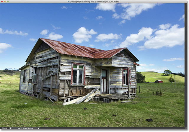 A photo of an old wooden house. Image licensed from Fotolia by Photoshop Essentials.com