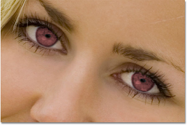 The eyes now appear red after changing their color in Photoshop. Image © 2010 Photoshop Essentials.com