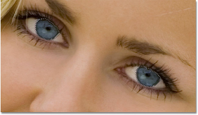 Drawing selectings around the eyes with the Lasso Tool in Photoshop. Image © 2010 Photoshop Essentials.com