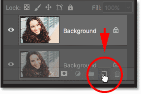 Dragging the Background layer onto the New Layer icon in the Layers panel in Photoshop
