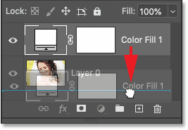 Dragging the Solid Color fill layer below the image in Photoshop's Layers panel