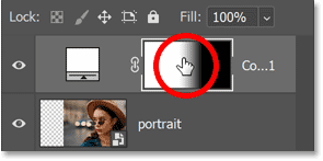 Holding Alt (Win) / Option (Mac) and clicking the layer mask thumbnail