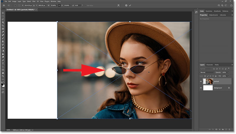 Dragging the subject to one side of the Photoshop document.