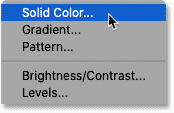 Choosing a Solid Color fill layer in Photoshop.