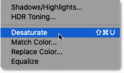 Choosing the Desaturate command in Photoshop.
