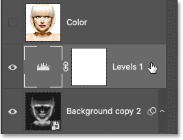 Selecting the Levels adjustment layer in Photoshop's Layers panel