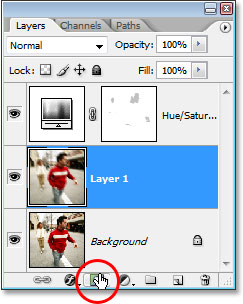 Clicking on the 'Layer Mask' icon at the bottom of the Layers palette.