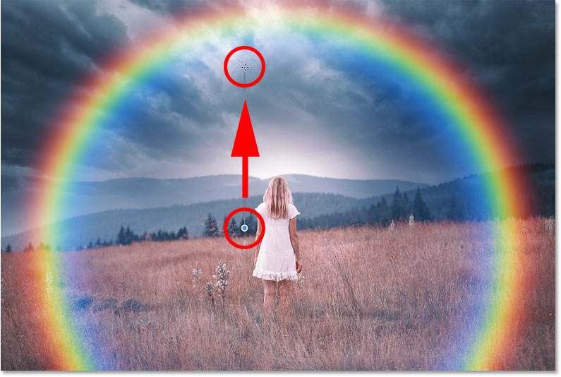 Drawing a black to white gradient on the layer mask to hide the bottom of the rainbow in Photoshop