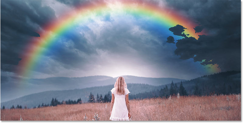 The dark clouds from the image are showing through the rainbow in Photoshop