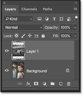 The Layers panel in Photoshop showing both images on separate layers