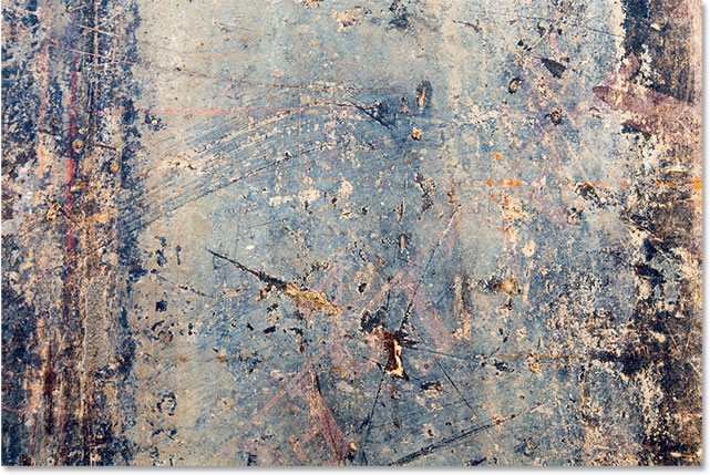 A rusted and scratched metal texture.