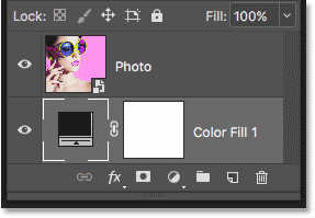 The Solid Color fill layer has been moved below the image layer.