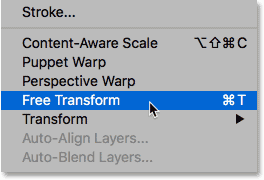 Selecting Free Transform from under the Edit menu in Photoshop.