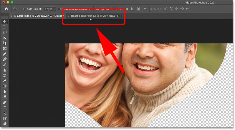 Dragging the shape onto the tab for the background image document in Photoshop