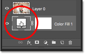 Double-clicking on the fill layer's color swatch in the Layers panel