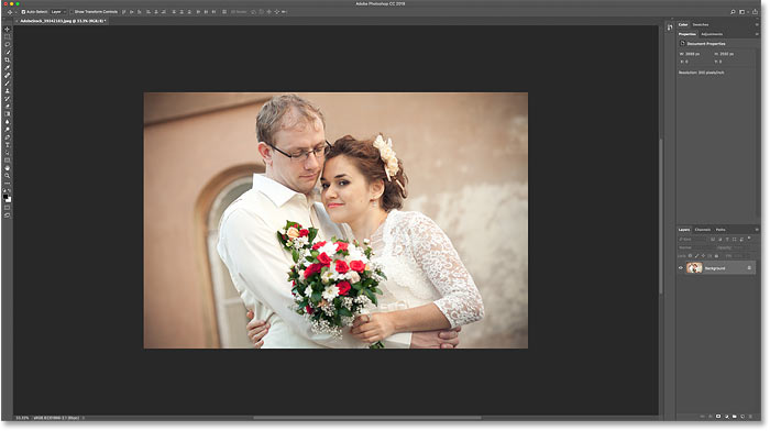 Zooming out of the image in Photoshop to make room for the photo border