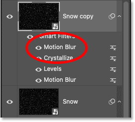 Photoshop's Layers panel showing the second Motion Blur smart filter applied to the Snow copy smart object