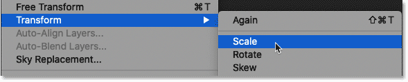 Selecting the Scale command in Photoshop.