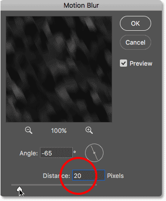 Increasing the Distance value in the Motion Blur dialog box.
