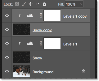 The Layers panel showing the copies of the Snow and Levels adjustment layer.