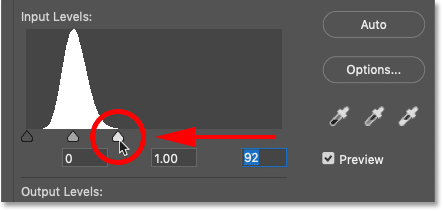 Dragging the white point slider in Photoshop's Levels image adjustment