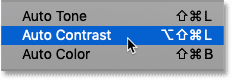 Selecting the Auto Contrast command in Photoshop