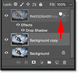 Dragging the Background copy layer above the Type layer in the Layers panel